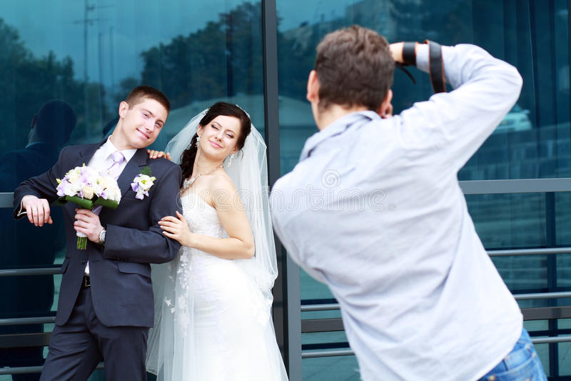 Fotograaf in actie stock afbeelding
