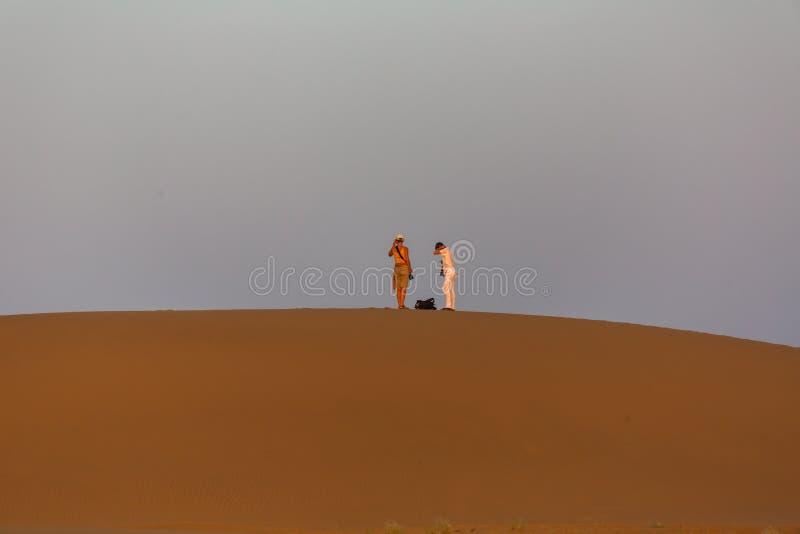 Fotograaf in de woestijn stock foto