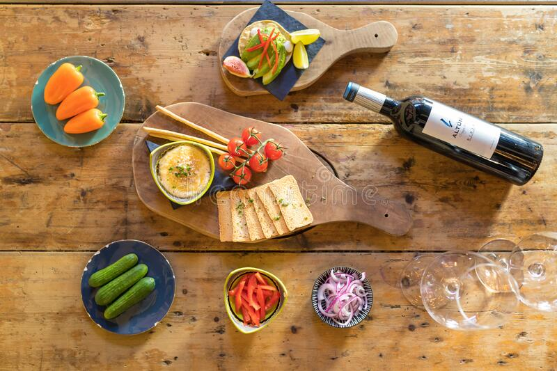 Appetizer on the table with a bottle of wine royalty free stock photos