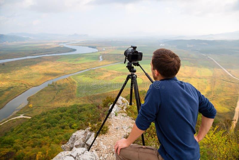 Fotograaflandschap op de cameraspruiten stock fotografie