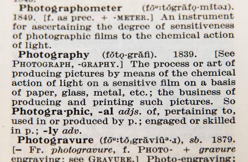 Fotografía de la palabra en una vieja página del diccionario imagen de archivo libre de regalías