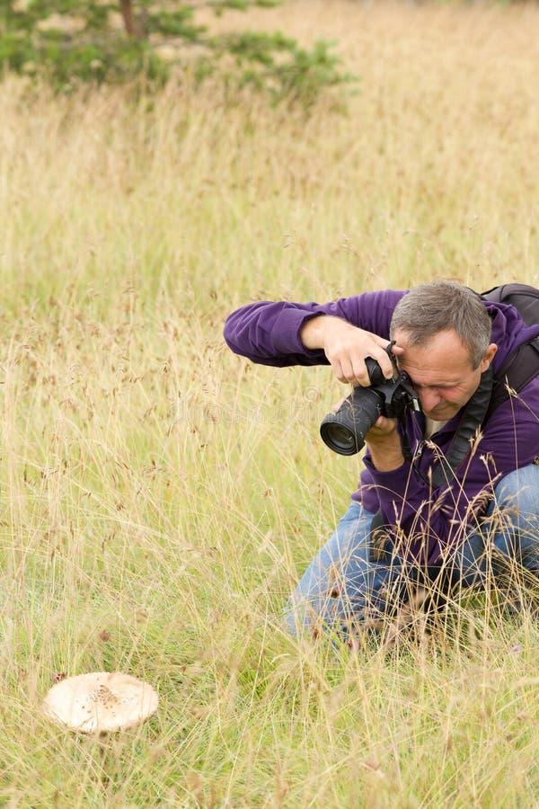 Fotograf in der Aktion lizenzfreie stockfotografie