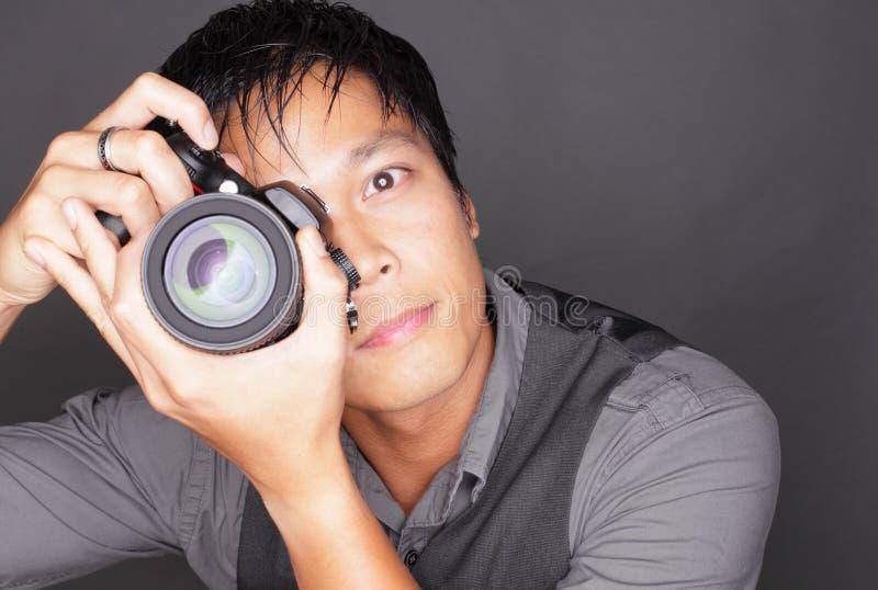 Fotograf, der ein Foto nimmt lizenzfreie stockfotos