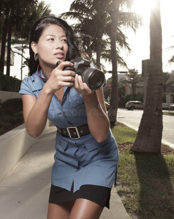 Fotograf in der Tätigkeit lizenzfreie stockbilder