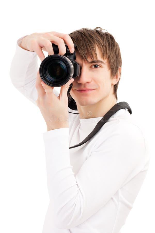 Fotograf in der weißen Holdingtelefonkamera lizenzfreie stockbilder