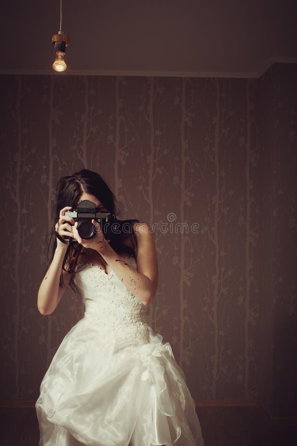 Fotograf i white arkivfoto