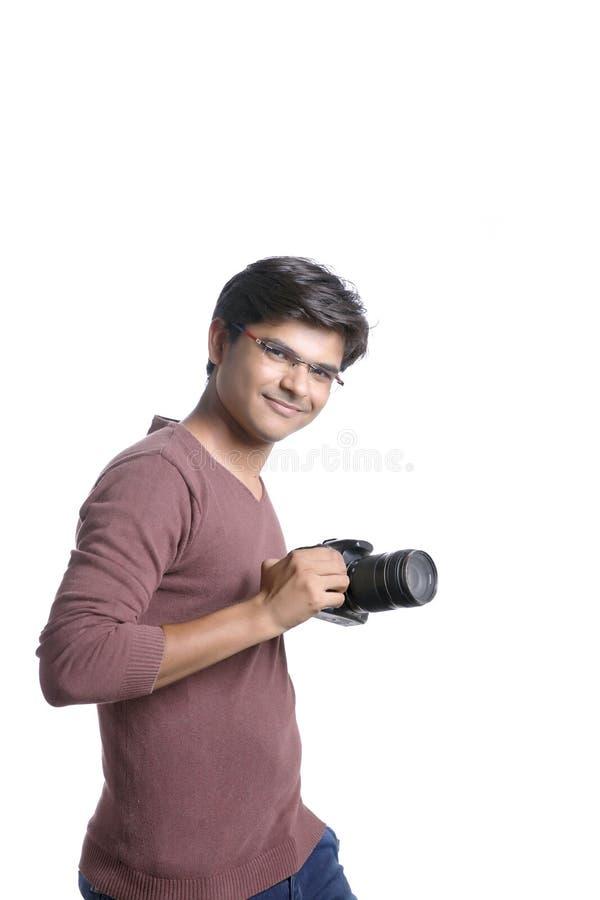 Fotograf med kameran arkivbild