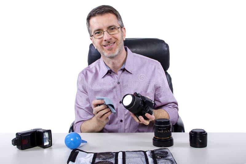Fotograf med utrustning arkivfoto