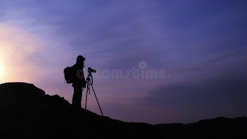 Fotograf am Sonnenaufgang stockfotos