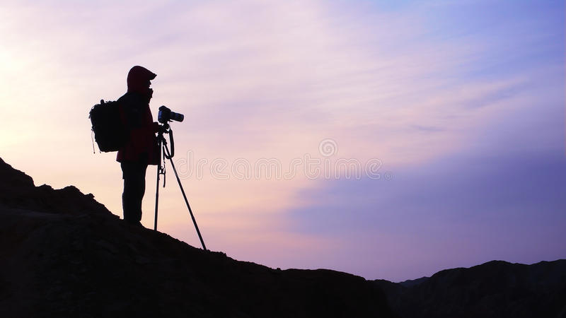 Fotograf am Sonnenaufgang lizenzfreie stockfotos