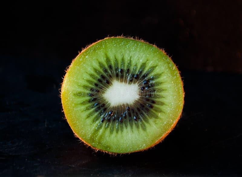 Fotografare della fetta del kiwi fotografia stock libera da diritti