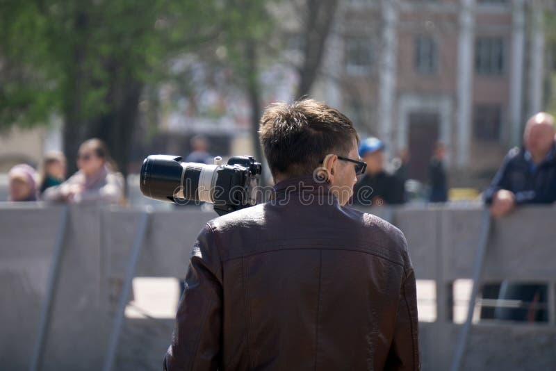 Fotografen die in scenary stad schieten E royalty-vrije stock foto's