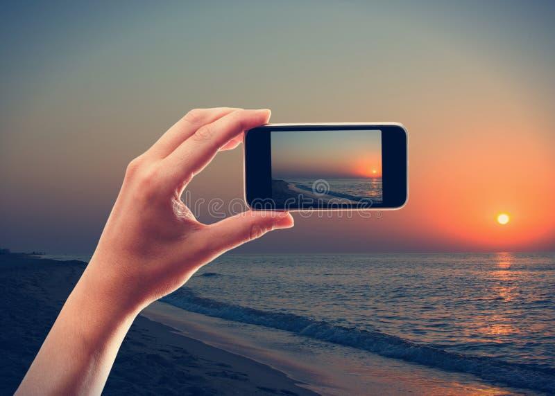 Fotografera soluppgången arkivbild