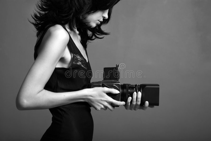 fotograferande barn för lady arkivfoton
