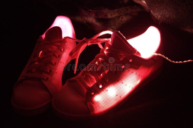 Fotografi av rosa gå skor arkivbild