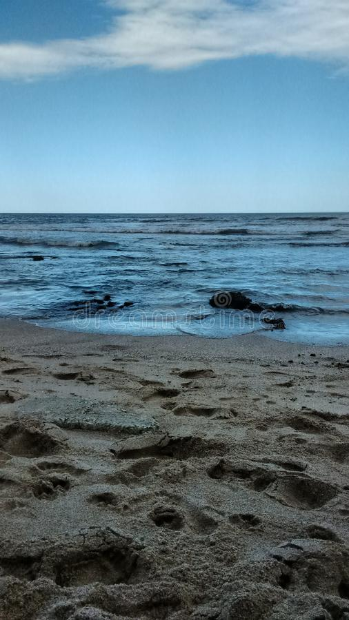 Fotografi av stranden av Miramar arenaceous arkivfoton