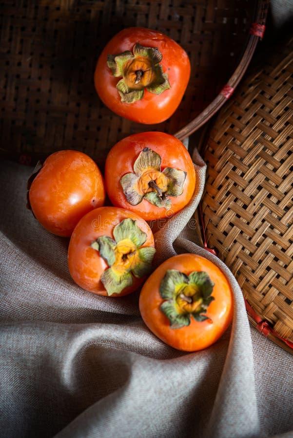 Fotografi för persimonfruktstilleben royaltyfri foto