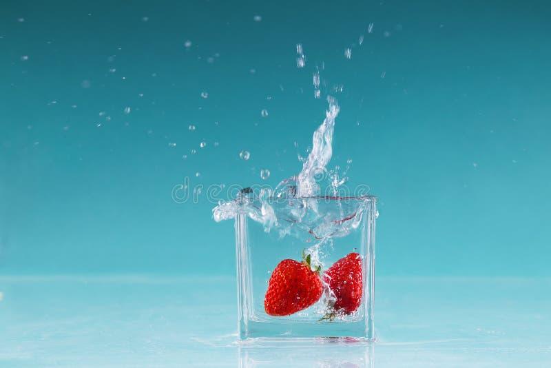 Fotografia de alta velocidade do fruto da morango imagem de stock
