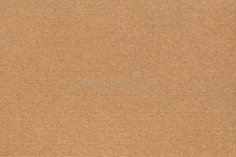 A fotografia de recicla a textura listrada do Grunge do papel de embalagem de Brown da grão grosseira fotos de stock