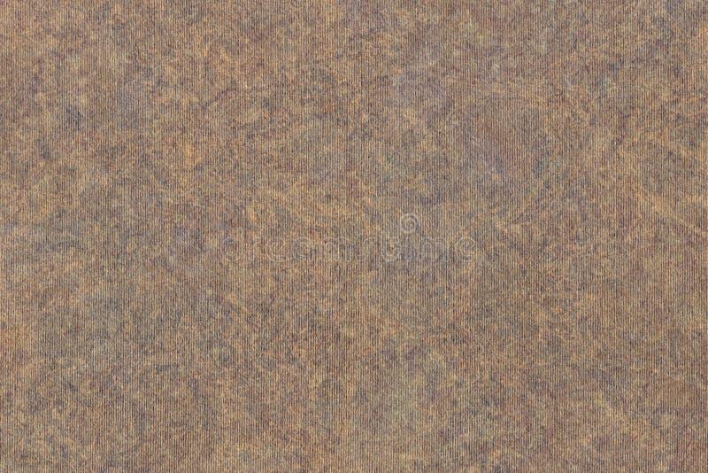 A fotografia de recicla a textura sarapintado listrada do Grunge do papel de embalagem de Brown da grão grosseira fotos de stock royalty free