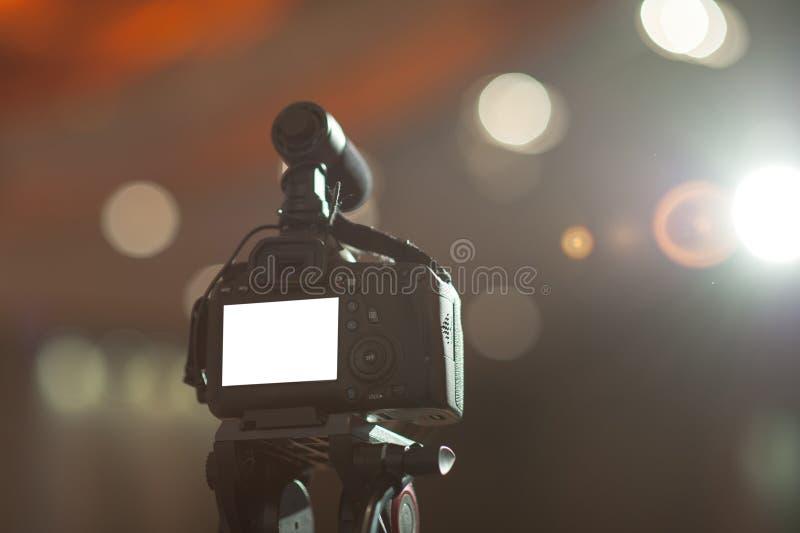 Fotografia della macchina fotografica, photo&vdo di Working del fotografo immagini stock libere da diritti