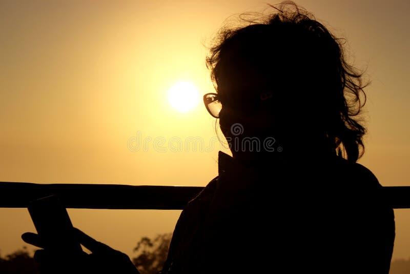 Fotografia della siluetta di una donna fotografie stock