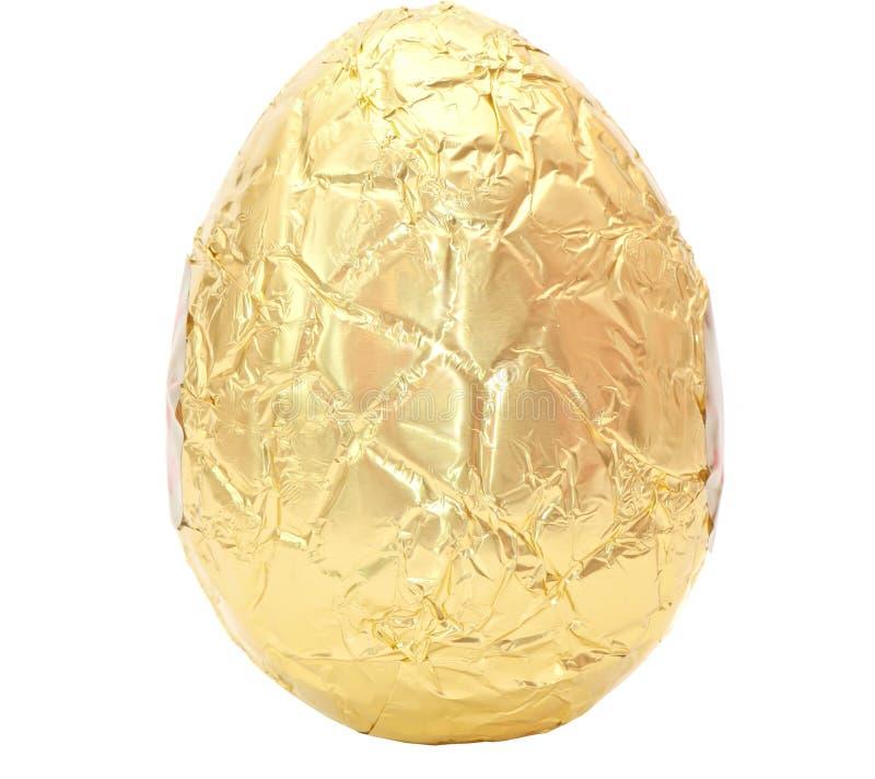 Fotografia Easter jajko zawijający w złocistej folii zdjęcie stock