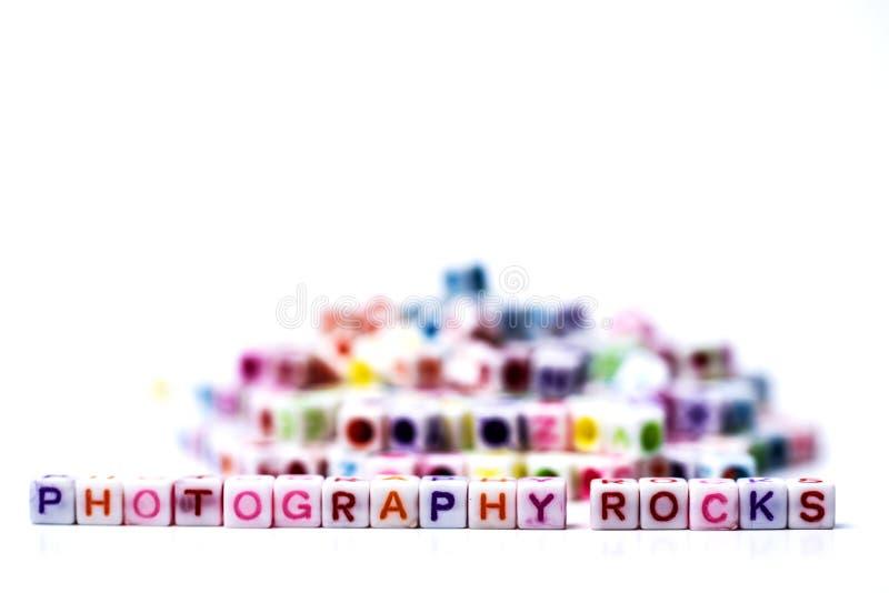 Fotografia Kołysa i Kołysa - konceptualnego podejście używać klingerytu listu płytki tworzy pisać dwa słów fotografii obraz royalty free