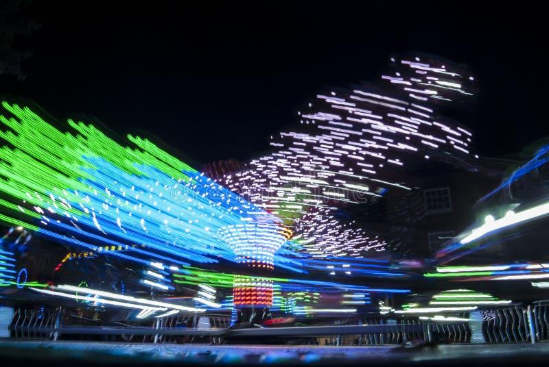 Fotografia longa da exposição Luzes do carrossel e movimentos, Reino Unido fotos de stock royalty free