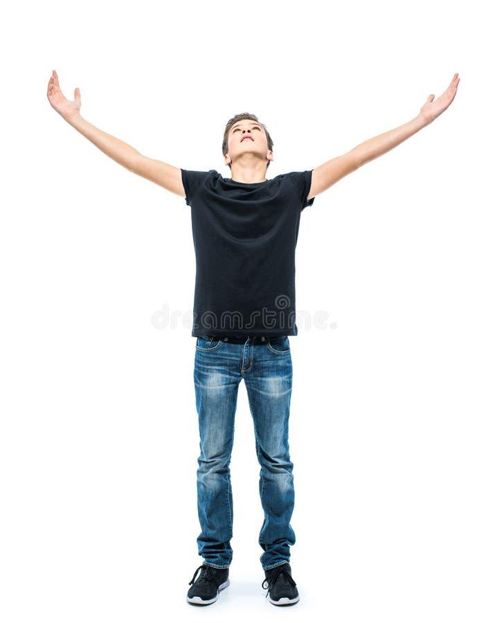 Fotografia nastoletnia chłopiec z nastroszonymi rękami up przy studiiem obraz stock