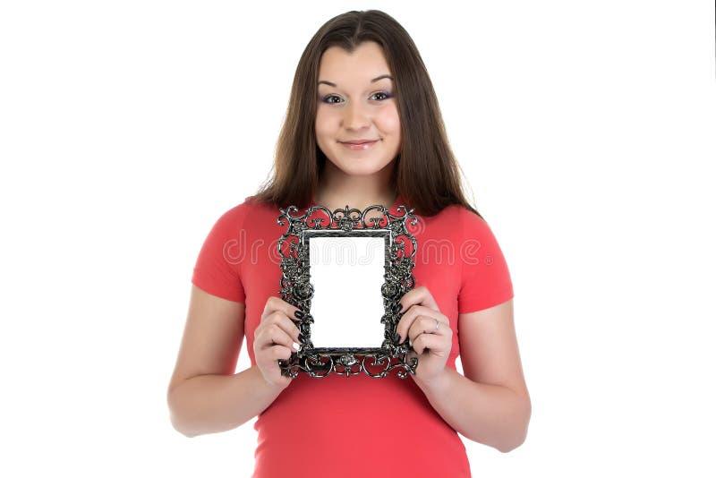Fotografia uśmiechnięta nastoletnia dziewczyna z fotografii ramą fotografia stock