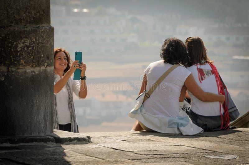 Fotografie della donna con una coppia di donne a Oporto, nell'ottobre 2013 portugal fotografia stock libera da diritti