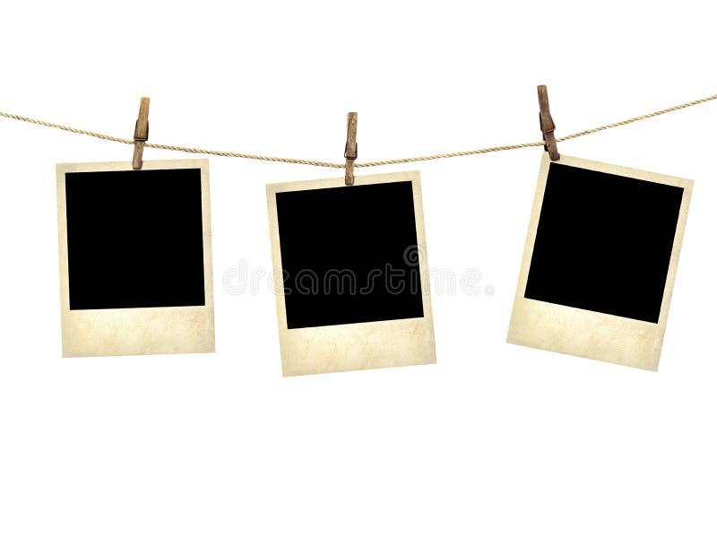 Fotografie di vecchio stile che appendono su una corda da bucato fotografie stock libere da diritti