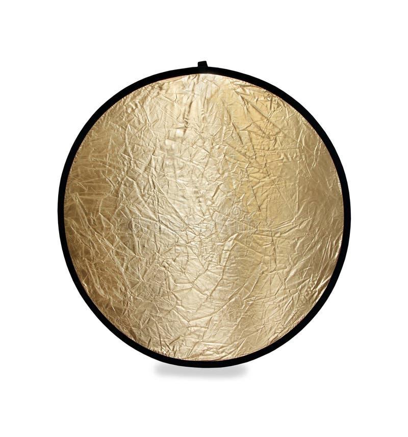 Fotografie lichte reflector in goud stock foto