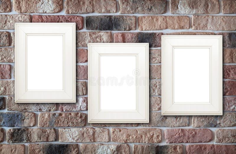 Fotografii ramy na ściana z cegieł obrazy royalty free