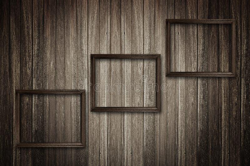 Fotografii ramy na ciemnej drewnianej ścianie ilustracja wektor
