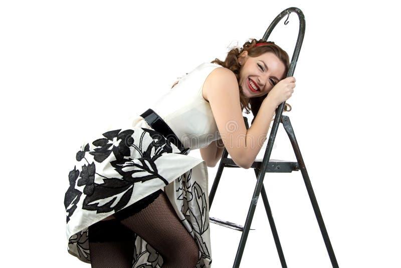 Fotografii uśmiechnięta szpilka w górę kobieta puszka schodki obraz stock
