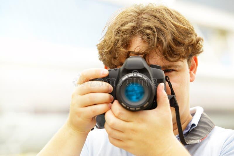 Fotografnehmen lizenzfreie stockbilder
