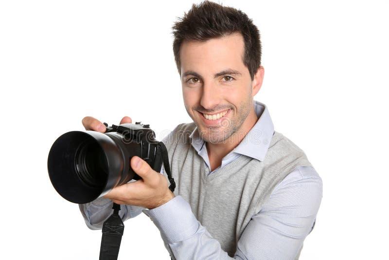 Fotografo con la macchina fotografica moderna fotografia stock