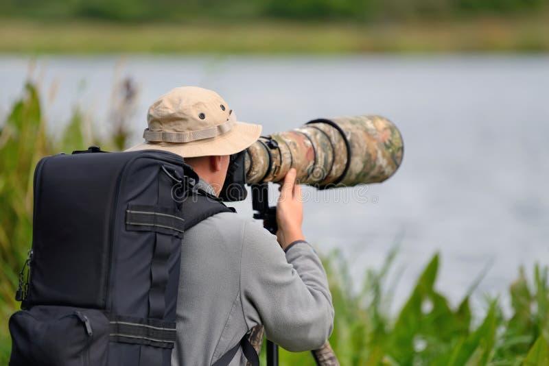 fotografo della fauna selvatica esterno fotografia stock