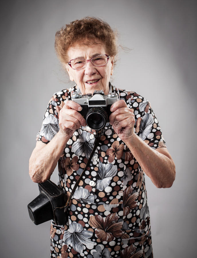 Fotografo della nonna fotografie stock