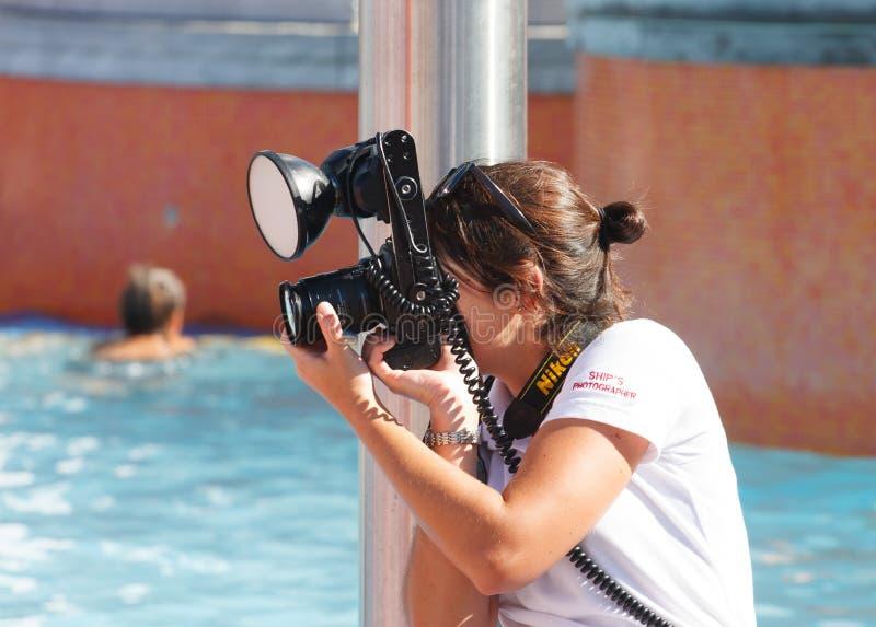 Fotografo delle navi con Nikon fotografia stock