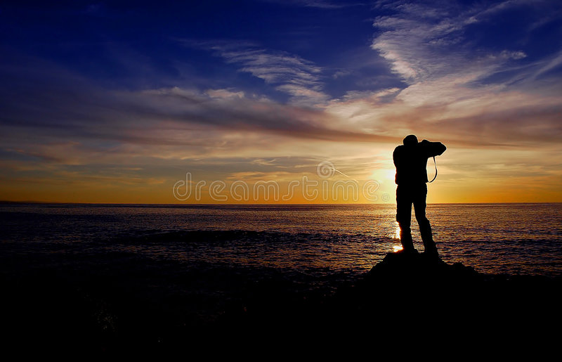 Fotografo Di Tramonto Immagine Stock