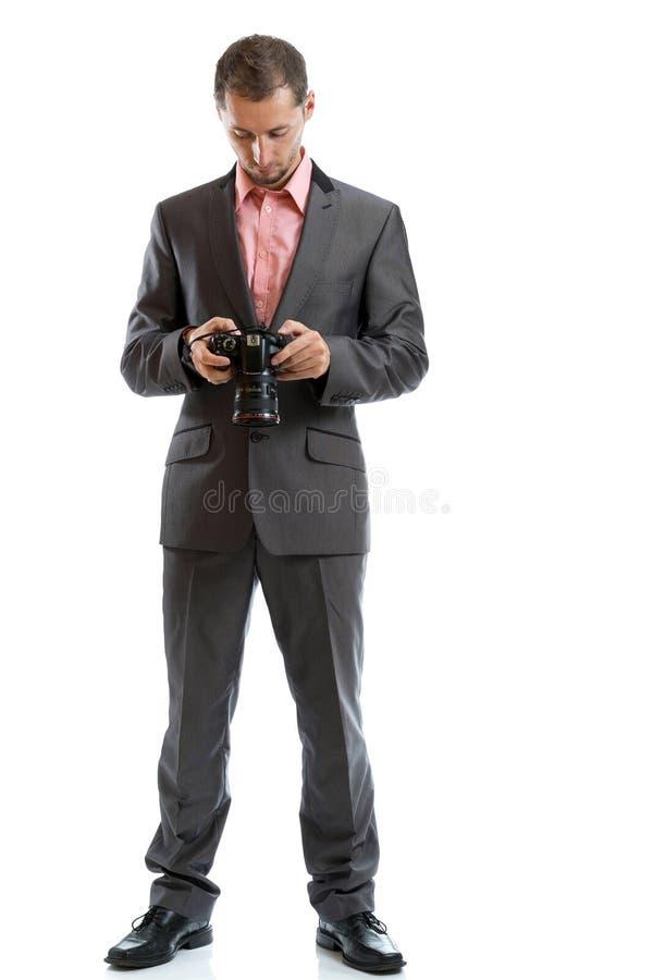 Fotografo integrale del legame del vestito con la macchina fotografica immagini stock