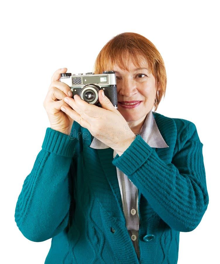 Fotografo maggiore con la macchina fotografica analog immagine stock