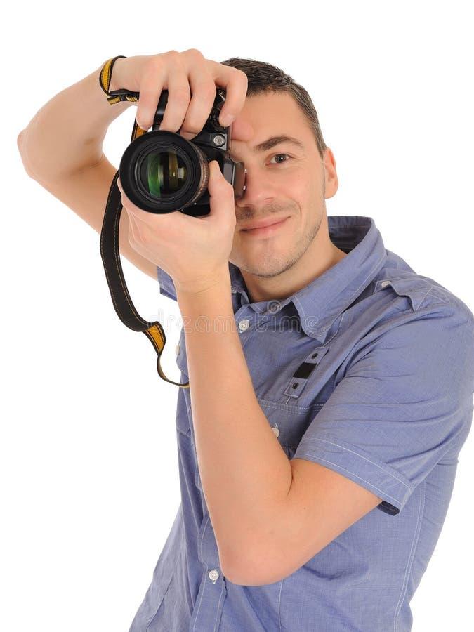 Fotografo maschio professionista che cattura maschera fotografie stock libere da diritti