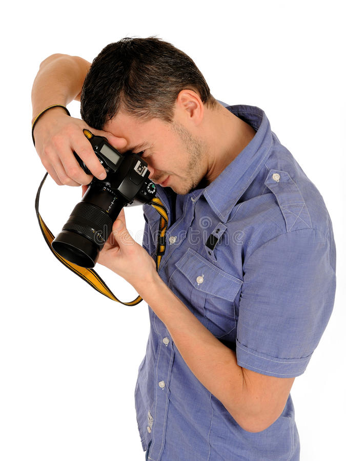 Fotografo maschio professionista che cattura maschera fotografie stock
