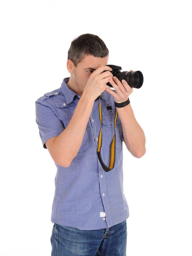 Fotografo maschio professionista che cattura maschera fotografia stock libera da diritti