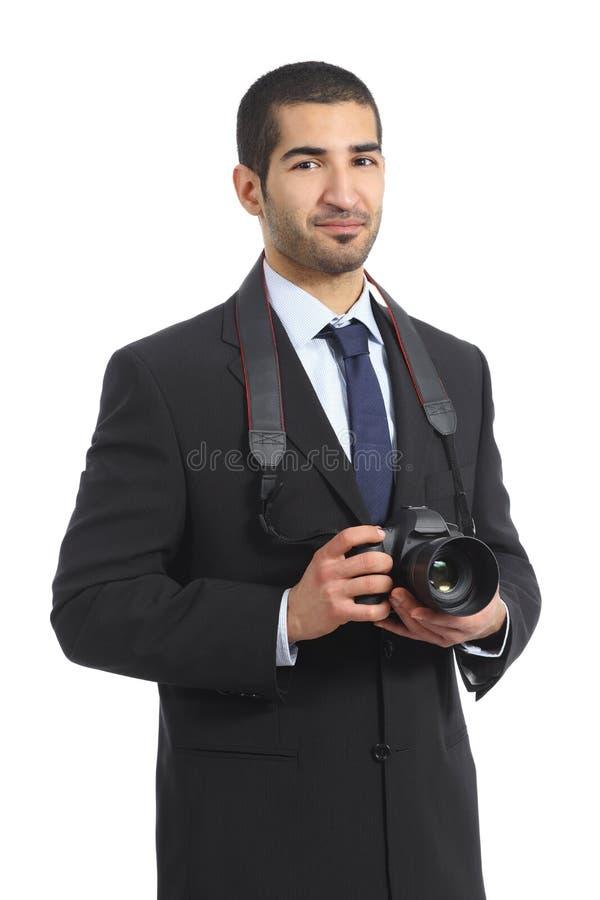 Fotografo professionista arabo che tiene una macchina fotografica digitale del dslr immagini stock libere da diritti