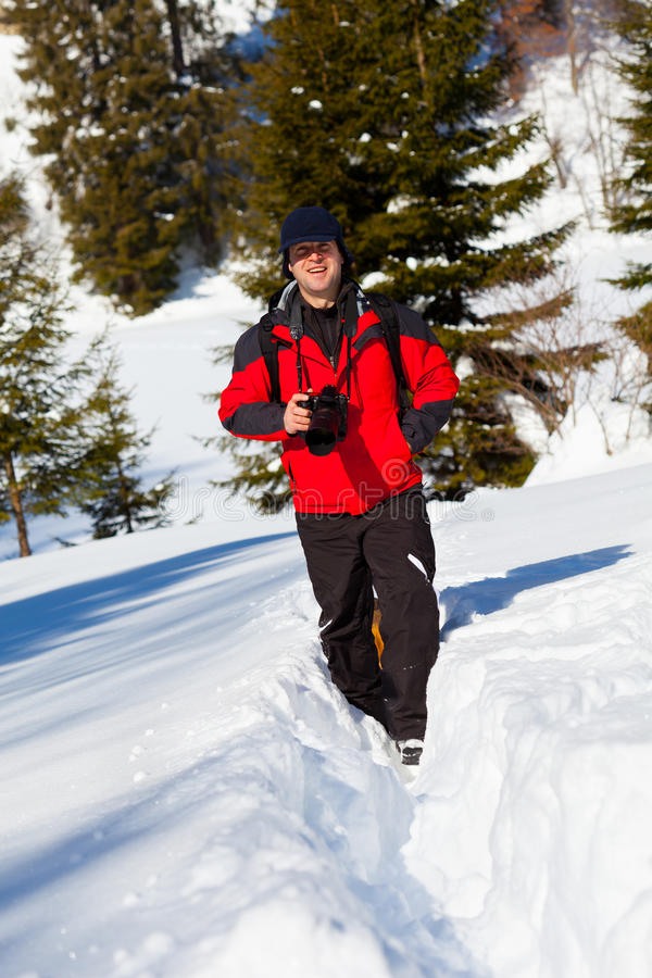 Fotografo professionista nel paesaggio di inverno immagini stock